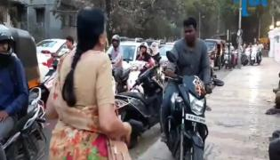Pune Elderly Woman Stops Bikers Riding On Footpath Schools Them - Sakshi