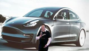 Tesla coming India? to set up research facility in Bengaluru - Sakshi