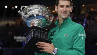 Novak Djokovic Beats Dominic Thiem To Clinch 8th Title Photo Gallery - Sakshi