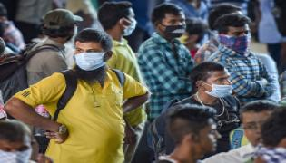 Corona virus people wearing face masks Photo Gallery - Sakshi