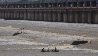 Prakasam Barrage 60 Gates Lifted In Krishna District - Sakshi