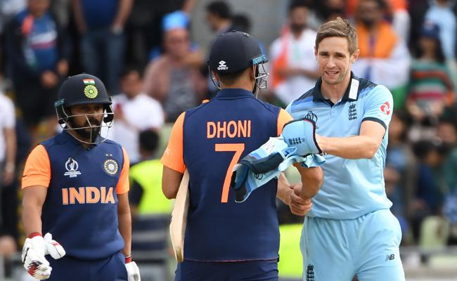 WORLD CUP ENGLAND BEAT INDIA 31 RUNS - Sakshi