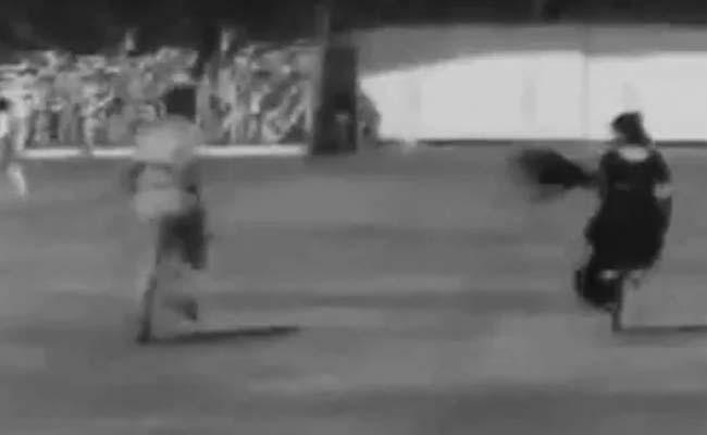Woman In Saree run To Cricket Match And Kisses Cricketer - Sakshi
