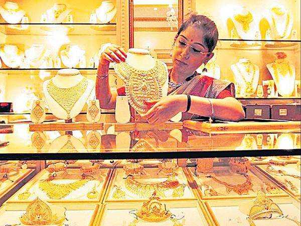 Observers opinion on gold in the near future  - Sakshi