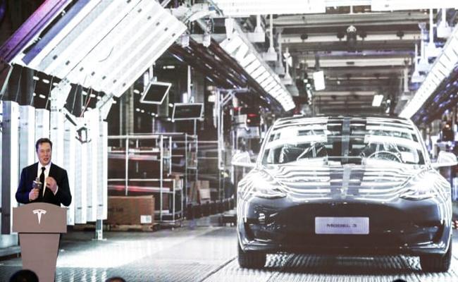 Elon Musk says will design a future Tesla car in China for global market - Sakshi