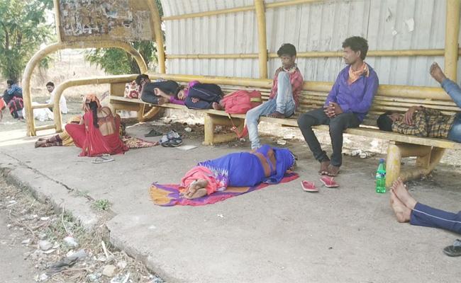 Migrant Workers Walking Hundreds of Kilometers in Summer Heat - Sakshi