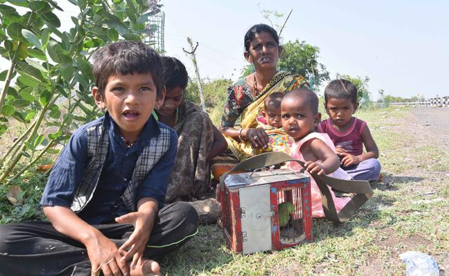 Migrant Workers Sit on Road Nirmal Bike Repair - Sakshi