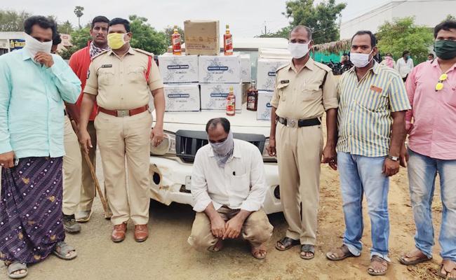 Teacher Held in Alcohol Smuggling West Godavari - Sakshi