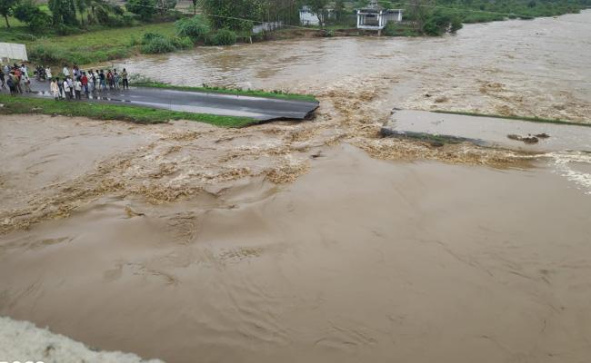 Bridge Collapse In Kodangal Tandur For Heavy Flood - Sakshi
