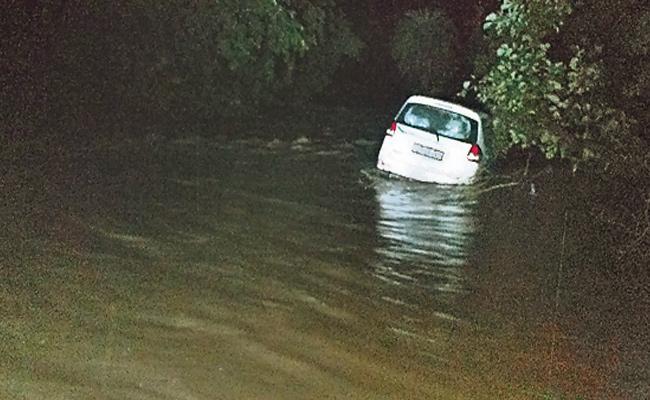 A Car Stuck in a Swamp at Midnight At Mahbub Nagar - Sakshi