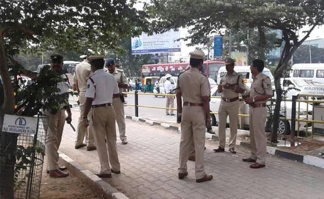 Ex Karnataka Minister Son Bengaluru Bungalow Raided In Drugs Case - Sakshi