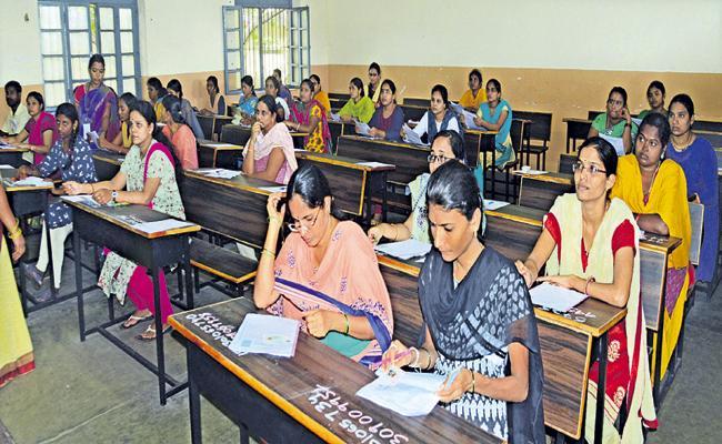 Written exams to fill the vacancies in the village and ward secretariats - Sakshi