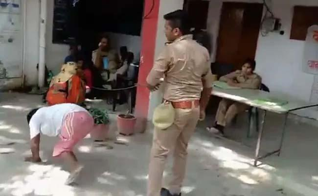 UP Cop Drags Differently Abled Man - Sakshi