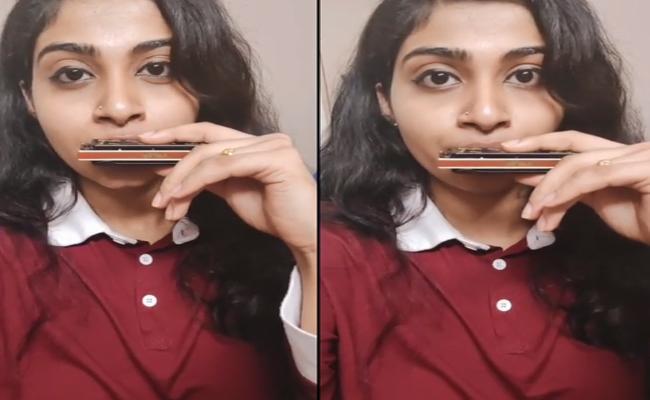 Bangalore Young Woman Creating Music Wonders With Harmonica - Sakshi