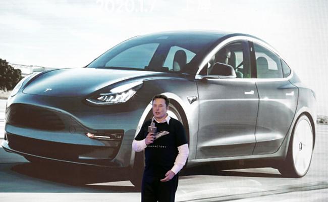 Tesla coming India? to set up research facility in Bengaluru - Sakshi