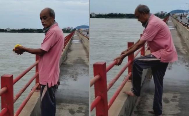 A Man Commits Suicide By Jumping Off The Kanakadurga Bridge - Sakshi