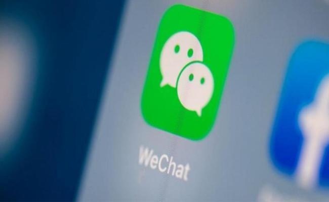 US court halts ban on WeChat download amid Trump tech battle with China - Sakshi